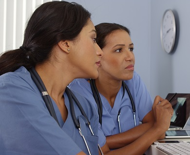 Two nurses in discussion